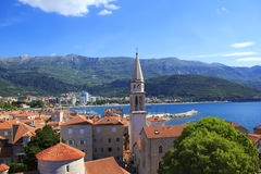 View of the rooftops and the bay of Budva in Montenegro. In the summer sunny day Stock Photo