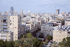 View on the rooftops of houses in Bat-Yam, Israel. ISRAEL, BAT-YAM, MARCH, 21, 2014 - View on the rooftops of houses with sunny batteries and heaters of water in Stock Images
