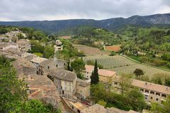 View on rooftops and Luberon valley in Menerbes, France stock images
