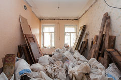 View room of the apartment and retro chandelier during under renovation, remodeling and construction.  Stock Image
