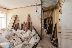 View room of the apartment and retro chandelier during under renovation, remodeling and construction. The process of disassembly old room and packing Royalty Free Stock Image