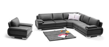 A view of a room with black sofa. A view of a room with leather sofa Royalty Free Stock Photography