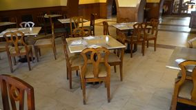 View of room with served tables in restaurant in hotel.  stock video footage