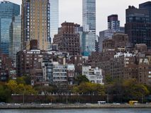 View from Roosevelt Island of midtown NewYork. View from Roosevelt Island  of midtown high rises New York. Afternoon light. East river shore, layered Royalty Free Stock Photography