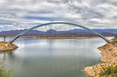 View of Roosevelt lake and bridge, Arizona. View of Roosevelt Lake and a bridge which are located at Apache trail scenic drive in Arizona, close to Phoenix. View Stock Photos