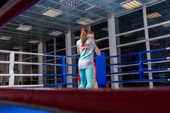 View through ropes of a regular boxing ring on young couple enga Royalty Free Stock Photo