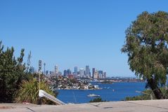 View Across Sydney Harbour to City Buildings, Australia. View from Rose Bay in Sydney`s Eastern Suburbs across the blue water of Sydney Harbour to Point Piper stock photo