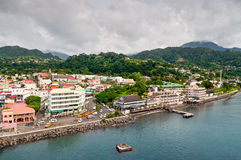 View of Roseu on a cloudy day, Dominica. Roseau, Dominica - December 4, 2011: A panorama of Roseau, capital of Dominica, taken from a ship overlooking the city stock photography