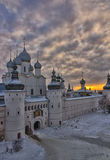 View of the Rostov Kremlin. The Rostov Kremlin in the winter against the setting sun Royalty Free Stock Photos