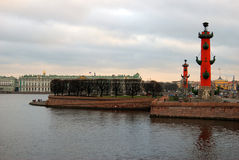 View of Rostral columns and Hermitage museum in Saint-Petersburg, Russia. Royalty Free Stock Photography