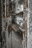 View into a rotting cell in an abandoned jailhouse Royalty Free Stock Photos