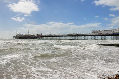 View of rough sea and Brighton pier in UK. View of rough sea and Brighton pier on a windy day, United Kingdom stock photo