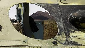 The view through a round hole in a tank. A steady, extreme close up shot of the amazing mountain landscape seen through a round hole in the body of a tank stock video
