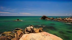 View Round Rock Stony Beach Azure Sea Skyline stock footage