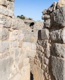 View of the round tower through the loophole of the middle tower of the western wall of Nimrod Fortress located in Upper Galilee. In northern Israel on the stock photography