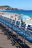 View of row of chairs and umbrellas on beach in Nice Stock Images
