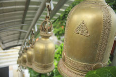 View of a row golden bells in buddhist temple Thailand,Asia Stock Photo
