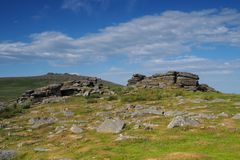 View from Rowtor with West Mill Tor in the background with white clouds in a blue sky, Dartmoor. National Park, Devon, UK Royalty Free Stock Photos