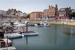 View of the Royal harbour and marina with town buildings in bac royalty free stock photos