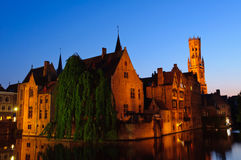 View from the Rozenhoedkaai at the Old Town of Bruges at dusk Royalty Free Stock Image