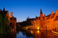 View from the Rozenhoedkaai at the Old Town of Bruges at dusk Royalty Free Stock Images