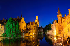 View from the Rozenhoedkaai of the Old Town of Bruges at dusk Stock Photo