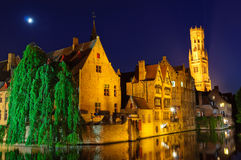 View from the Rozenhoedkaai of the Old Town of Bruges at dusk Royalty Free Stock Images