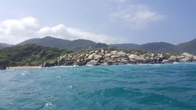 View of a rugged beach and jungle from the ocean. View of a beach, jungle and ocean in Tayrona National Park, North Colombia Stock Image