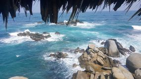 View of a rugged beach. And ocean from the hut in cabo san juan  in Tayrona National Park, North Colombia Stock Photo