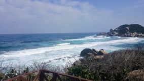 View of a rugged beach. And ocean in Tayrona National Park, North Colombia Stock Photos