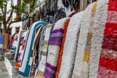 View of rugs on the outside of a shop, in a village in the south stock images
