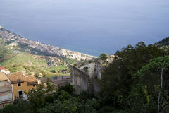 View on a ruin of Forza d`Argro and on Sant Alessio Siculo Royalty Free Stock Photos