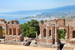 View of ruined Teatro Greco and Ionian Sea coast. Travel to Sicily, Italy - view of ruined walls of Teatro antico di Taormina, ancient Greek Theater & x28;Teatro Royalty Free Stock Photos