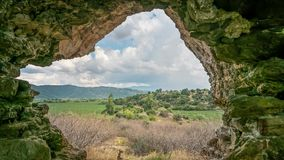 View from ruins of ancient Myus tunnel looks out. To spectacular valley and cloudscape, Turkey. Time lapse 4K stock video
