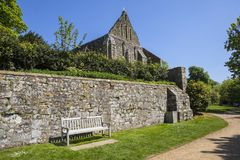 Ruins of Battle Abbey in Sussex. A view of the ruins of the dormitory of Battle Abbey, located in the town of Battle in East Sussex stock photo