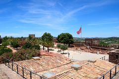 Medieval castle and courtyard, Silves, Portugal. View of the ruins and gardens within the Medieval castle with battlements and towers to the rear, Silves Royalty Free Stock Images