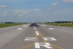 View of the runway with the airliner away Royalty Free Stock Photo