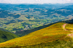 View of rural area from the high hillside. Lovely summer landscape in Carpathian mountains Royalty Free Stock Photos