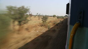 View on rural landscape in Jodhpur from a moving train. stock footage