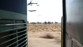 View on rural landscape in Jodhpur from train door during ride. stock footage