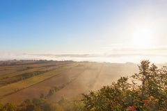 View of rural landscape in morning mist Royalty Free Stock Photo