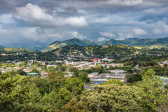 View of rural Puerto Rican town in the valley. At the base of the mountains with cloudy stormy sky Stock Photography
