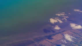 View Rural Seacoast from Airliner Window. Panorama of rural seacoast from airliner window stock video