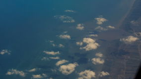 View Rural Seacoast from Airliner Window. Panorama of rural seacoast from airliner window stock footage