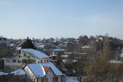 View of the rural settlement from a height in winter in sunny weather stock images