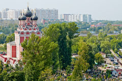 View of Russian Orthodox church of Tikhvin Icon of Our Lady. With five domes and Alekseevskoye cemetery near to church stock images