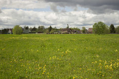 View of the Russian village. Green meadow. Summer Stock Photos