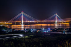 View of Russkiy bridge at night, Vladivostok,  Russia Stock Photo