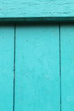 View on rustic painted wooden turquoise shutter background Royalty Free Stock Photos