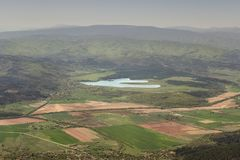 View from a Ruy mountain vantage point at a curvy lake stock image
